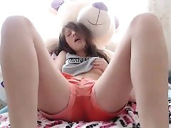 Black-haired teenage milks wooly puss in scorching solo sequence