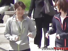 Athletic Asian teenagers change clothes in public