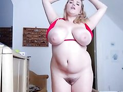 Chubby blonde with giant boobs and immense snatch taking off her swimsuit