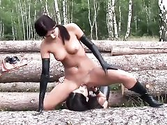 Nasty bitches wearing latex in the forest and deepthroating their labia holes