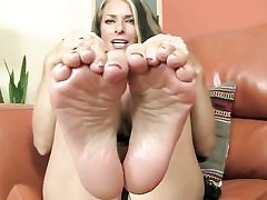 Sweet looking babe is exposing her feet and is prepped to give footjob