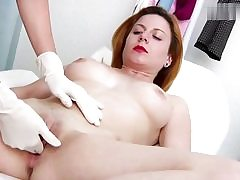 Mischievous crimson haired stunner gets her cunt crevice examined on a gynecology stool